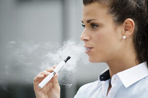 young female smoking e-cigarette vaping